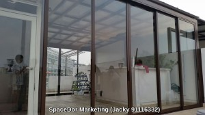 Enclose sliding glass door with aluminium composite shelter at attic floor